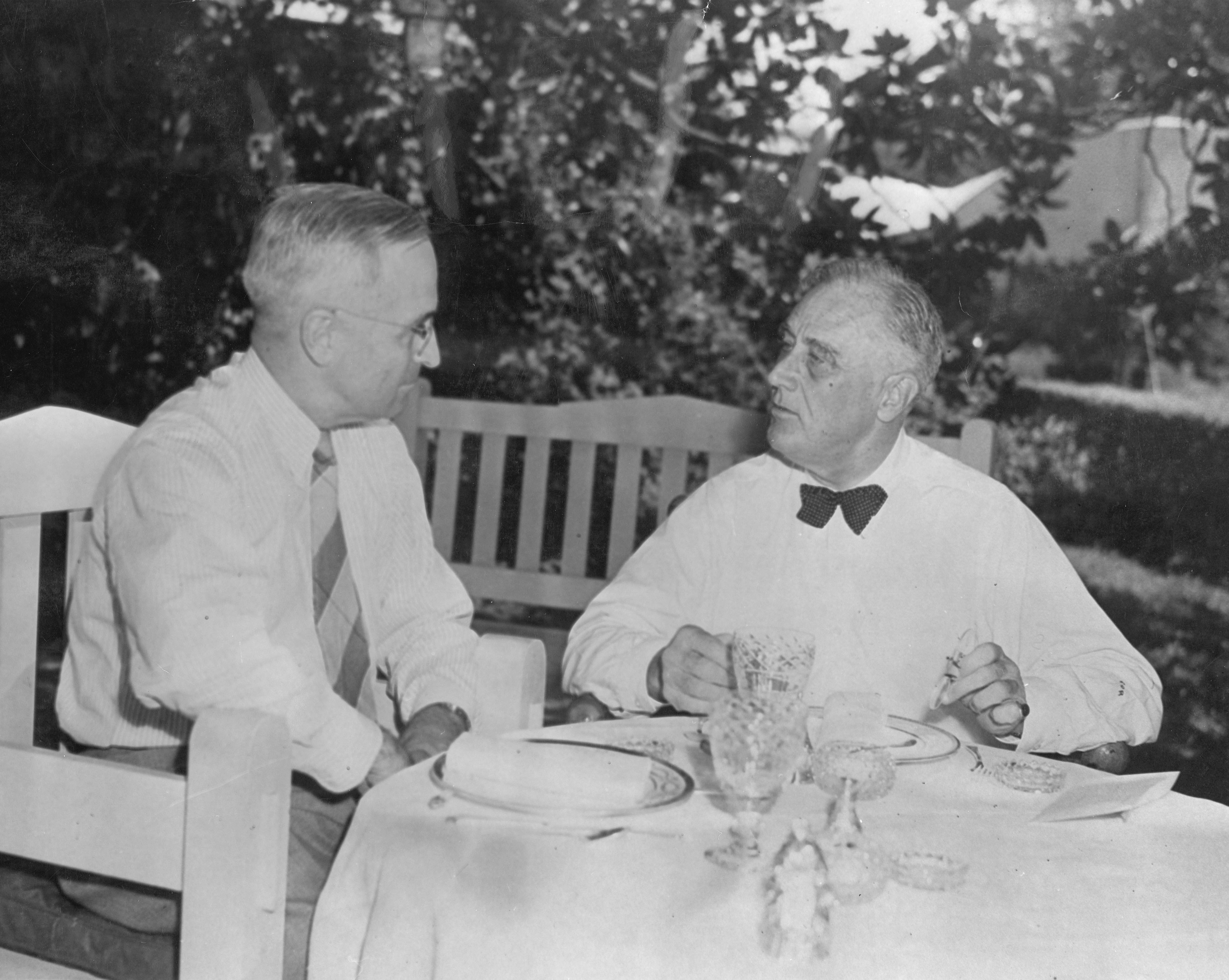 Senator Harry S. Truman of Missouri, Democratic vice presidential candidate is shown having lunch with President Roosevelt on the south lawn of the White House, August 18, 1944. NPx 61-504.