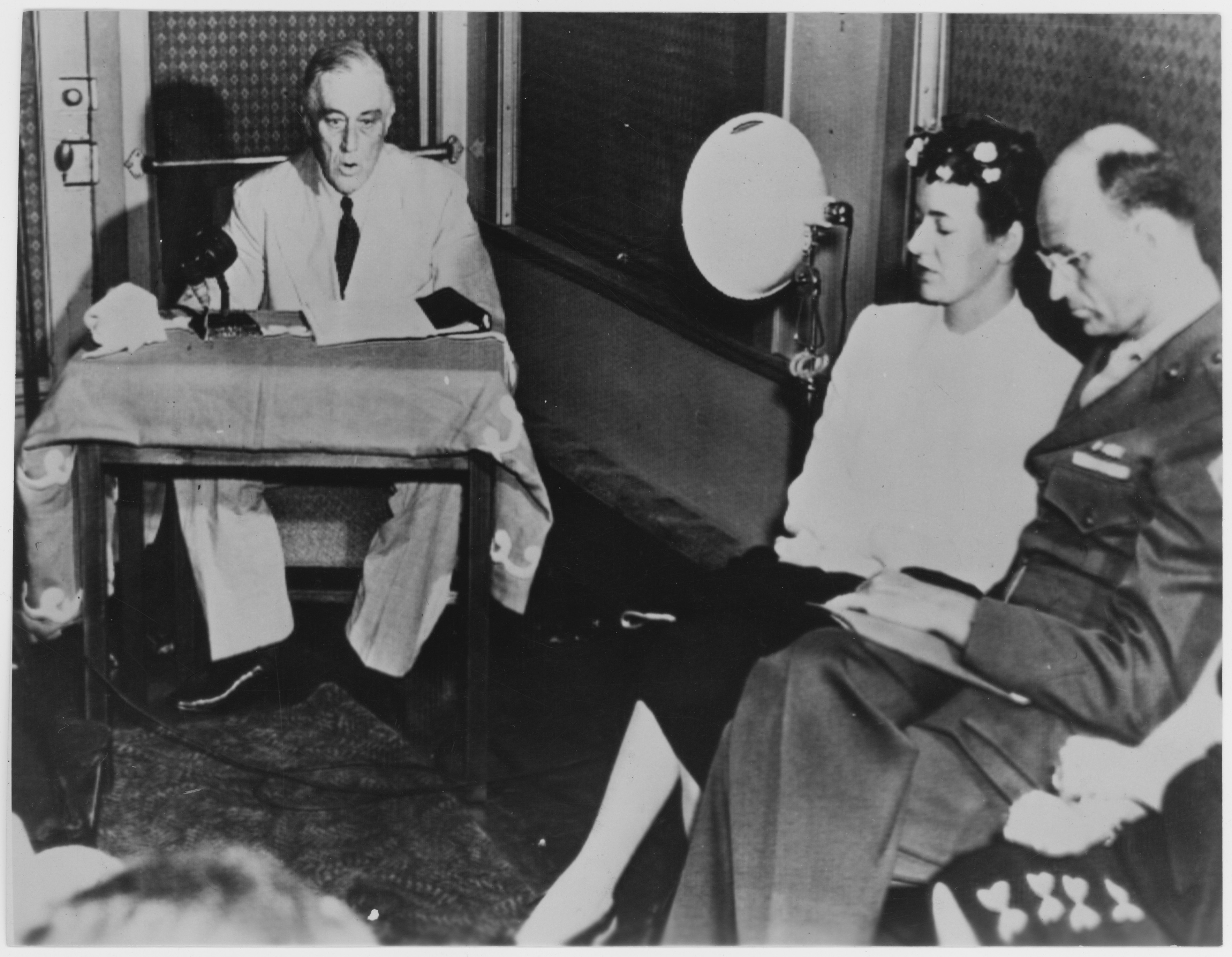Franklin D. Roosevelt accepts nomination by DNC at Chicago from train at San Diego, California with Mr. & Mrs. James Roosevelt, July 20 1944. NPx 69-26