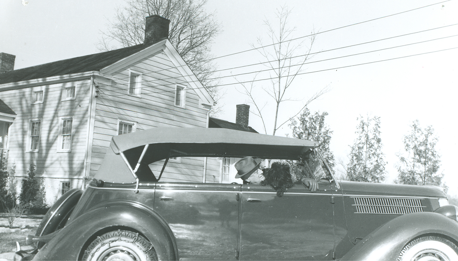 FDR with Fala in his car - Ford Phaeton in front of Mr. Linaka's house, Hyde Park, New York, February 1941. NPx 73-113:59.