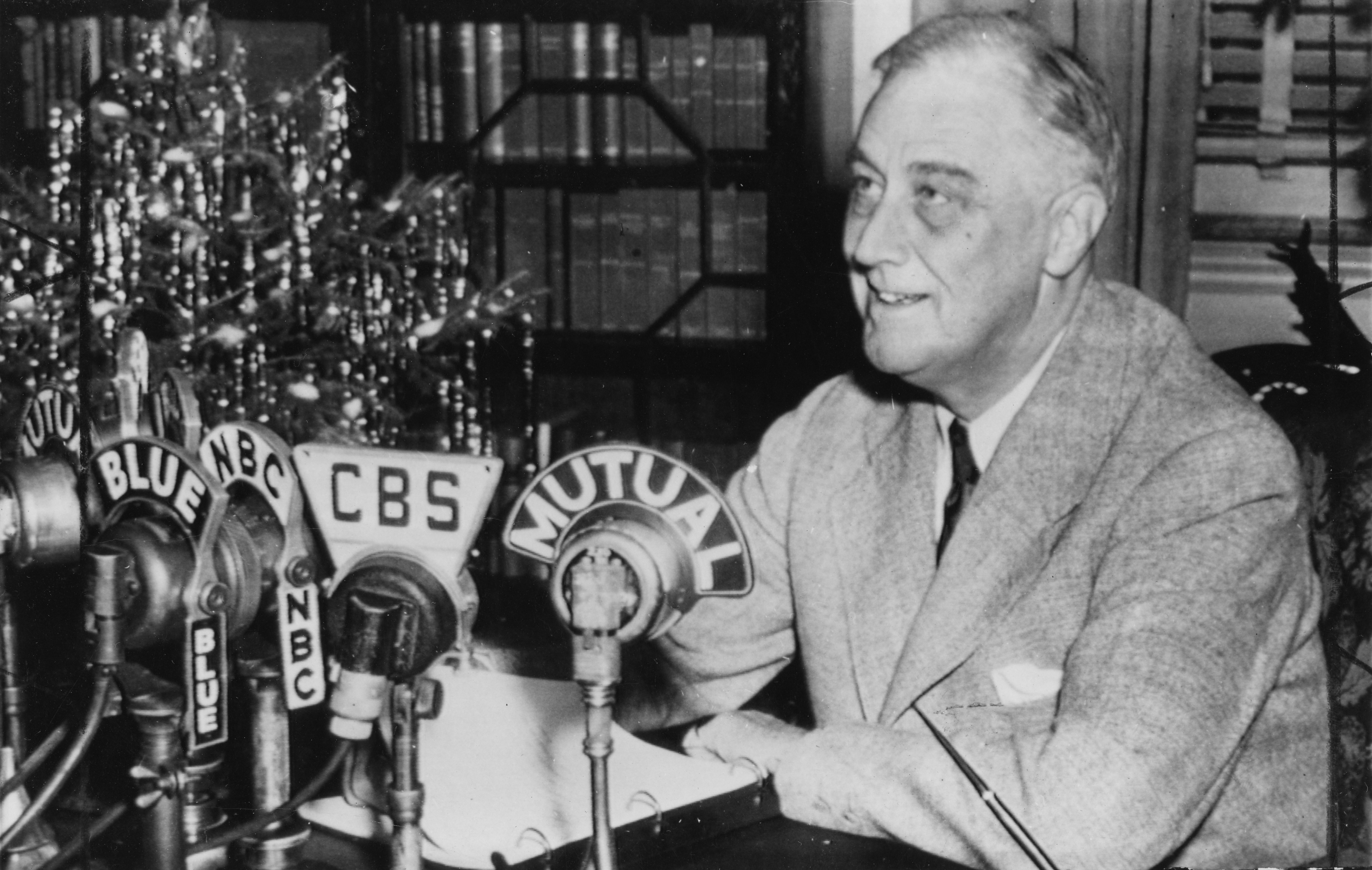 FDR broadcasts Christmas message announcing Dwight D. Eisenhower as Commander in Chief of Allied forces in Europe from his study in the Library, Hyde Park, NY. December 24, 1943.