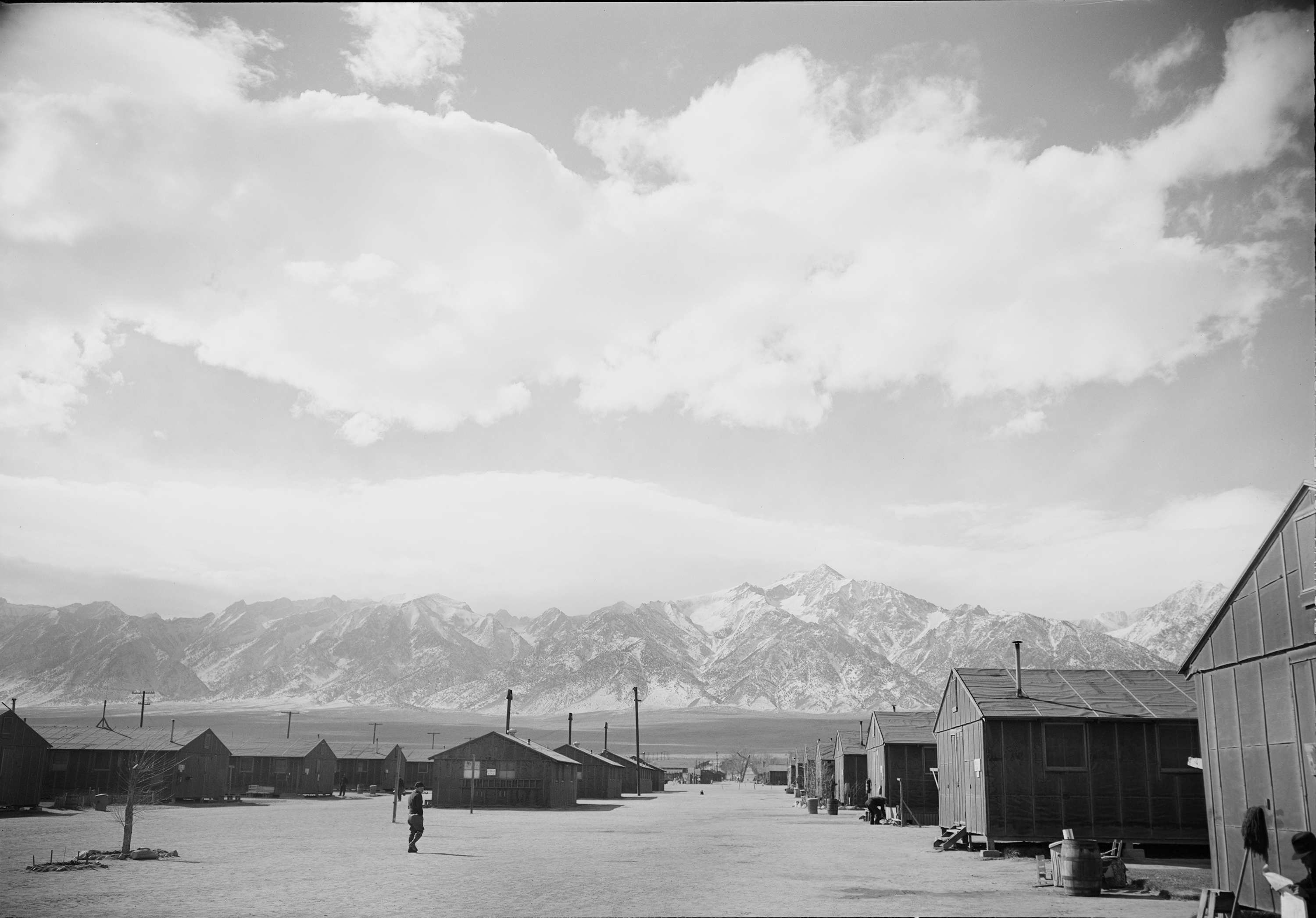 Rows of housing units at the Manzanar Relocation Center. This camp was located 230 miles northeast of Los Angeles at the eastern slope of the Sierra Nevada Mountains. Ansel Adams 1943